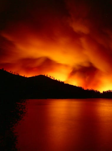 The Carr Fire explodes in  Whiskeytown as it begins pushing to the outskirts of Redding late Wednesday, July 2018 into the early hours of Thursday, July 26, 2018. The fire moved east from French Gulch toward Whiskeytown Lake late Wednesday night. Hung T. Vu/Special to the Record Searchlight