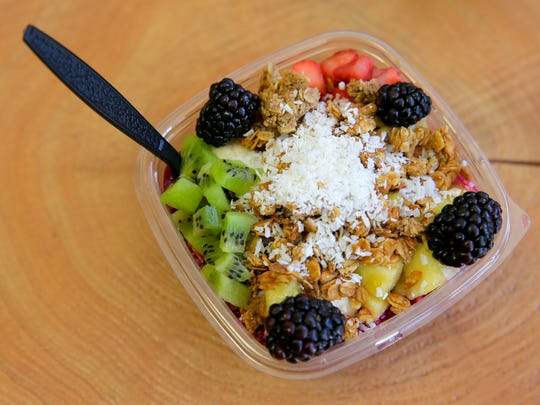 The Kitchen Sink bowl, a pitaya base topped with banana,