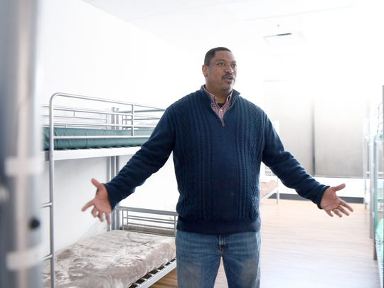 Micheal Woods, executive director of Western Carolina Rescue Ministries, talks about the challenges the shelter faces during Code Purple in one of the women's dorms of the downtown shelter. When the shelter has extra women the area between bunks is lined with cots.