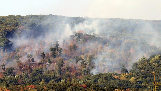 Several Putnam County fire departments are assisting Connecticut firefighters with a large brush fire on top of a mountain overlooking Squantz Pond in New Fairfield Sunday.