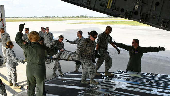 The 920th Rescue Wing at Patrick Air Force Base hosts the 5th Annual MEDBEACH joint medical response exercise on March 4-5. The training involved about 250 participants and included the mock treatment and transporting of injured Air Force personnel, who were loaded into a C-17 Globemaster aircraft.