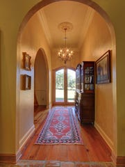The foyer of the home is full of light, showcasing old world materials.