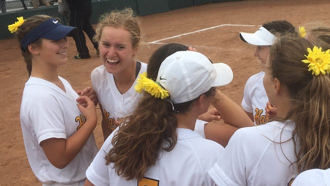Madelin Skene (second from left) is all smiles after hitting a two-run homer in the eighth inning to give Hartland a 4-2 victory over South Lyon in the regional championship softball game at Novi on Sunday, June 10, 2018.