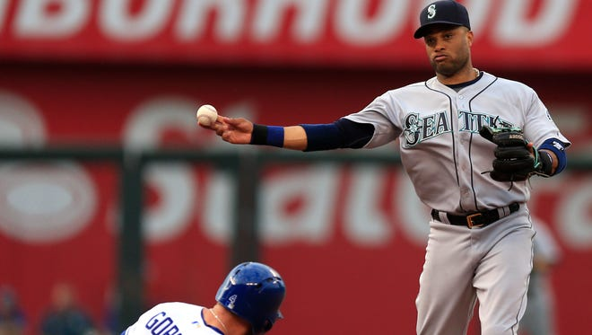 Seattle Mariners second baseman Robinson Cano, right, forces out Kansas City Royals' Alex Gordon (4) while turning a double play in the first inning of a baseball game at Kauffman Stadium in Kansas City, Mo., Thursday, July 7, 2016. Kansas City Royals designated hitter Kendrys Morales was out at first base on the play. (AP Photo/Orlin Wagner)