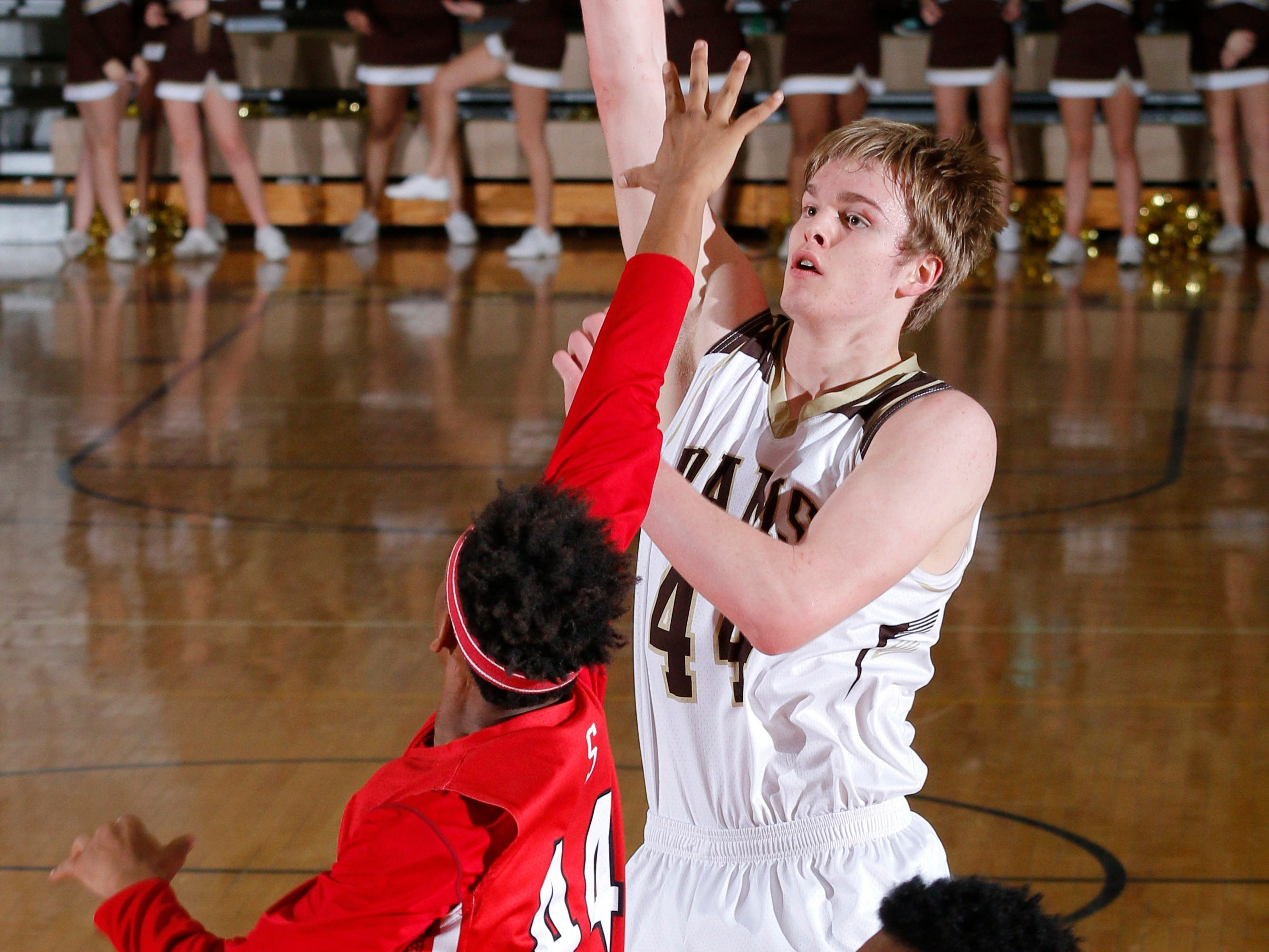 Holt's Jaron Faulds, right, shoots over Sexton's Shayne Scruggs Tuesday, Feb. 17, 2015, in Holt. Holt won 54-53.