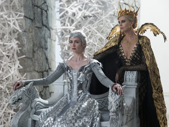 Emily Blunt and Charlize Theron appear in a scene from