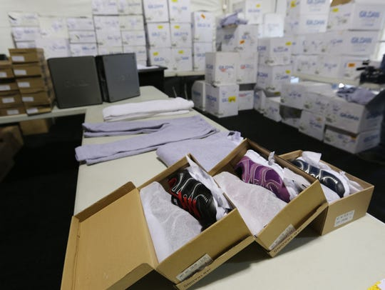 Boxes of shoes and warm-ups were on display in the