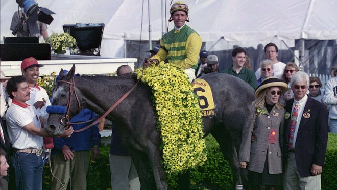 In this May 17, 1997, file photo, jockey Gary Stevens sits on Silver Charm in the Winner's Circle after winning the 122nd running off the Preakness at Pimlico Race Course in Baltimore. Trainer Bob Baffert stands at right. Former Kentucky Derby winner Silver Charm has returned to Kentucky to live out his days as a celebrity at a retirement farm.