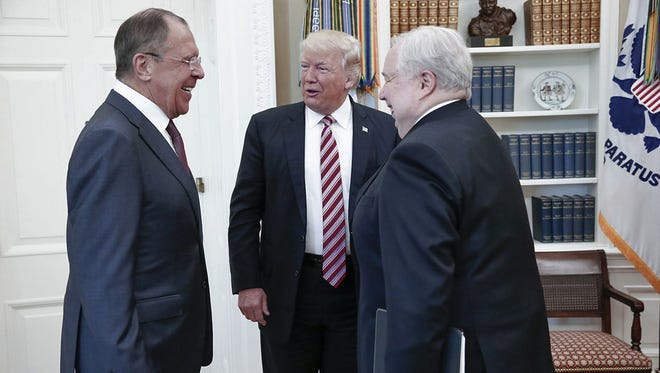 President Donald Trump meets with Russian Foreign Minister Sergei Lavrov, left, next to Russian Ambassador to the U.S. Sergei Kislyak at the White House in Washington,  May 10, 2017.