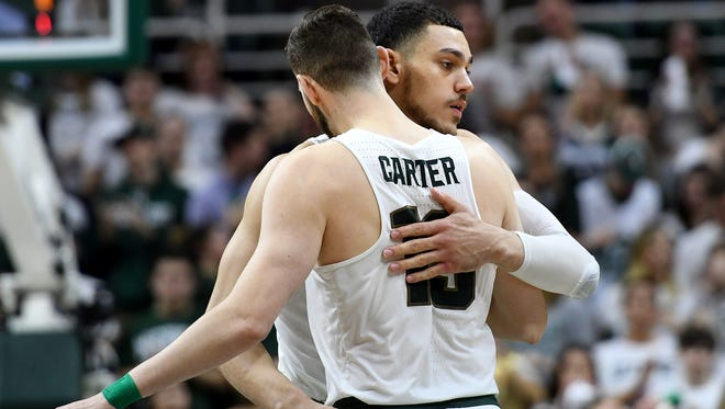 Michigan State's Gavin Schilling, right, hugs fellow senior Ben Carter before tipoff during the first half on Tuesday, Feb. 20, 2018, at the Breslin Center in East Lansing.