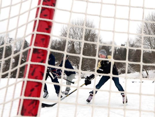 PHOTOS: Pond hockey on Lake Redman