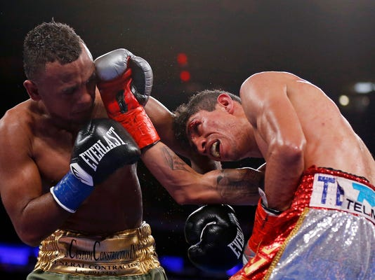 Rey Vargas, of Mexico, punches Oscar Negrete, of Colombia, during the 12th round of a WBC junior featherweight title boxing match Saturday, Dec. 2, 2017, in New York. (AP Photo/Adam Hunger)
