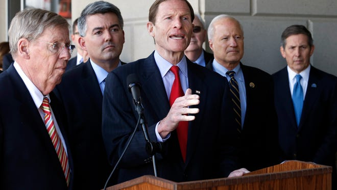 Ranking Democrat on the Senate Veterans' Affairs Committee Sen. Richard Blumenthal, D-Conn., center, flanked by Sen. Johnny Isakson, R-Ga., far left, who is chairman of the committee, speaks to members of the media following a U.S. Senate delegation tour of the over-budget Veterans Administration hospital complex, which is under construction, in Aurora, Colo., Friday, April 24, 2015. Also pictured are, from right, Veterans Affairs Deputy Secretary Sloan Gibson, U.S. Rep. Mike Coffman, R-Colo., and U.S. Sen. Cory Gardner, R-Colo. (AP Photo/Brennan Linsley)
