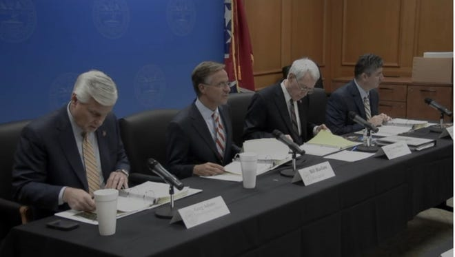 Gov. Bill Haslam (second from left) has directed state agencies to prepare budgets this year with a 7 percent cut. Several agencies will present their budget proposals Tuesday.