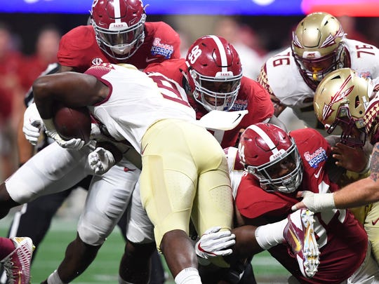 Alabama DL Raekwon Davis tries to tackle Florida State