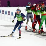 Hannah Dreissigacker of Morrisville, Vt., skis after shooting during the first-ever Olympic biathlon mixed relay at Laura Cross-Country Ski and Biathlon Center.
