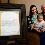 Jim and Larisa Barth with their daughter Kamari share the Montana certificate of birth resulting in a stillbirth belonging to her son Asher, who was stillborn in 2011.