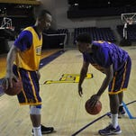 Twin brothers Malcolm, left, and Martin Smith rank third and first in scoring this season, respectively, for the Lipscomb men's basketball team.