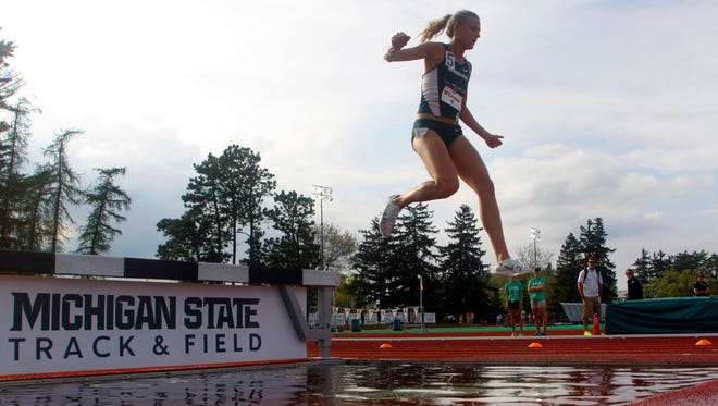 MSU's Leah O'Connor jumps over the water jump during the 3000 meter steeplechase during the Big Ten Track and Field championships