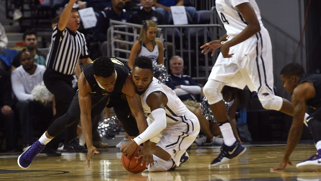Nevada's D.J. Fenner fight for a loose ball against San Francisco State's Chiefy Ugbaja during their exhibition game last Friday.