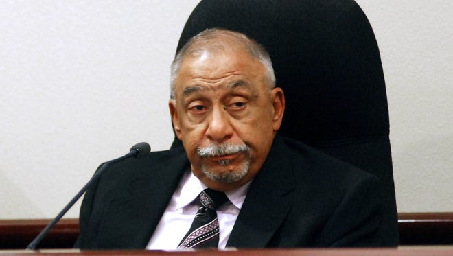 Former New Mexico state Sen. Phil Griego testifies at his own trial on corruption charges on Tuesday, Nov. 14, 2017, in Santa Fe, N.M. Griego, a Democrat, is accused of using his former position as a lawmaker to profit from the sale of a state-owned building in downtown Santa Fe without proper disclosure. He denies any wrongdoing.
