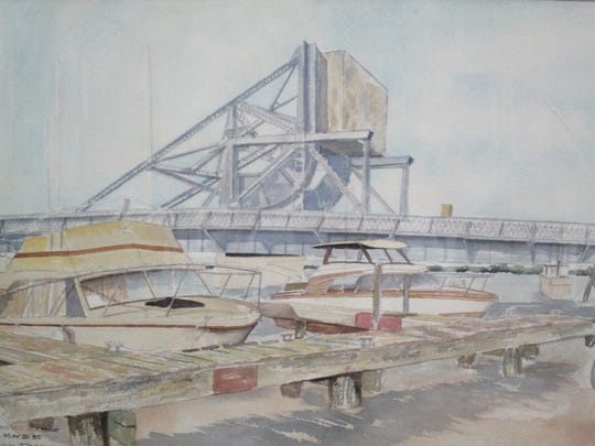 The old Kewaunee draw bridge is featured in two of the paintings by the late Madison professor Ron Daggett that will be auctioned on Nov. 1 to benefit the Kewaunee Public Library.