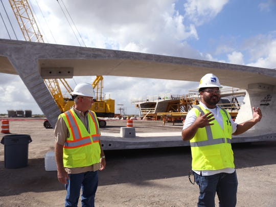 Flatiron/Dragados, LLC employees Darrell Chambers (left), maintenance of traffic engineer, and Justin Guevara, project engineer, give a tour of the Flatiron/Dragados, LLC Pre-Cast Yard on Friday, October 6, 2017.