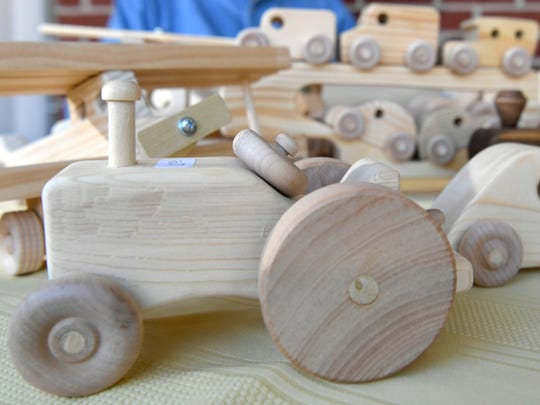 """""""My toys are made to be played with,"""" says Don Stockton of Columbia, who makes wooden toys in his wood shop behind his home."""