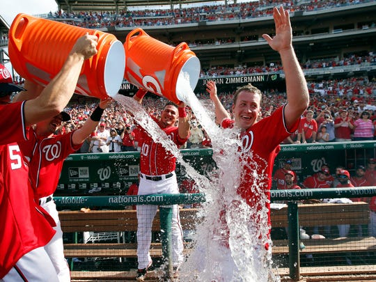 Washington Nationals starting pitcher Jordan Zimmermann is doused by his teammates after his no-hitter Sunday against the Miami Marlins at Nationals Park.