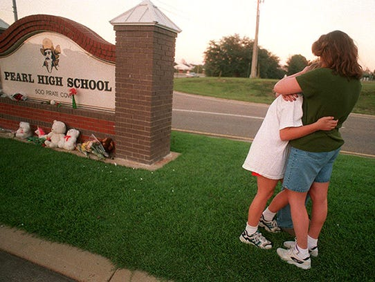 This 1997 photo shows a Pearl Junior High School student