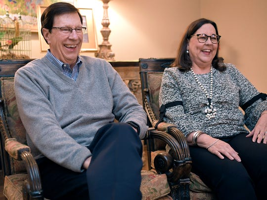 David Poile laughs with his wife, Elizabeth, at their