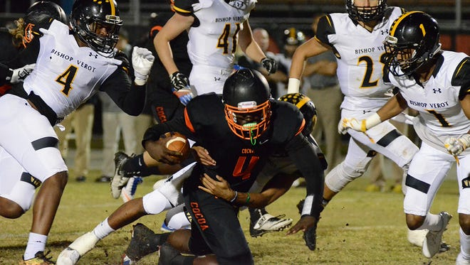 Bruce Judson gets taken down after gaining yardage Friday night as Bishop Verot Vikings visited Cocoa.