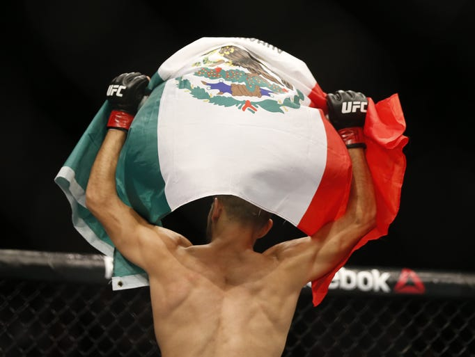 Yair Rodriguez celebrates his win over BJ Penn in a