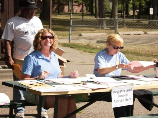 In this file photo, volunteers register participants