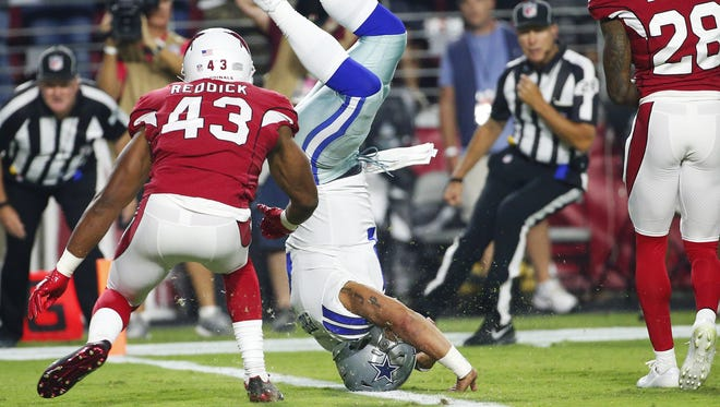Dallas Cowboys quarterback Dak Prescott (4) scores a touchdown ahead of Arizona Cardinals inside linebacker Haason Reddick (43) during the second quarter of Monday Night Football at University of Phoenix Stadium in Glendale, Ariz. September 25, 2017.