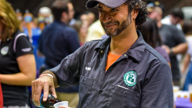 Sami Parbhoo serving a cold one at Gulf Brew 2016 at Blackham Coliseum. July 30, 2016