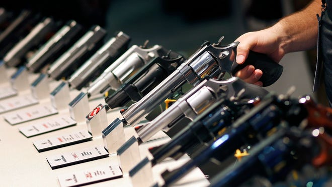 Handguns are displayed at a trade show in Las Vegas on Jan. 19, 2016.