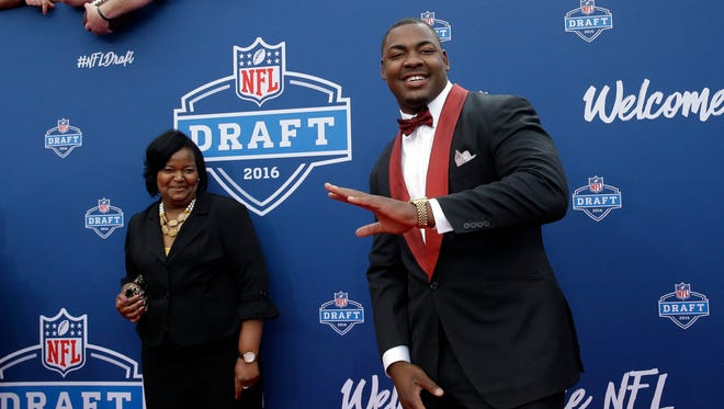 Mississippi State''s Chris Jones, right, poses for photos upon arriving for the first round of the 2016 NFL draft in Chicago. Jones was not selected in the first round.