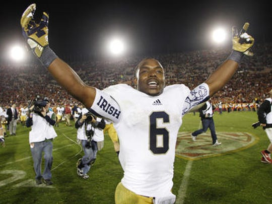 Notre Dame running back Theo Riddick celebrates after Notre Dame defeated Southern California 22-13 in an NCAA college football game, Saturday, Nov. 24, 2012, in Los Angeles