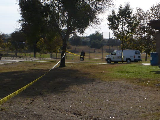 A Tulare County Coroner's office van drives to a body