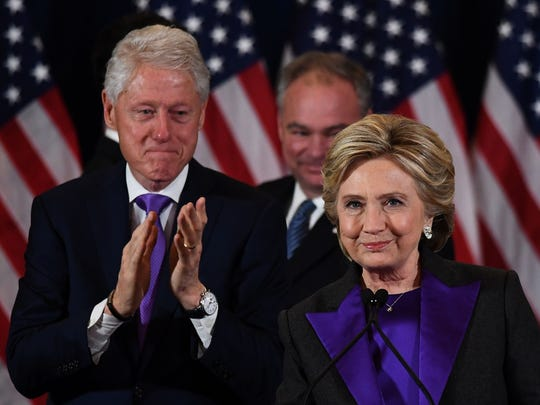 Hillary Clinton makes a concession speech in New York on Nov. 9, 2016, as former president Bill Clinton and running mate Tim Kaine look on.