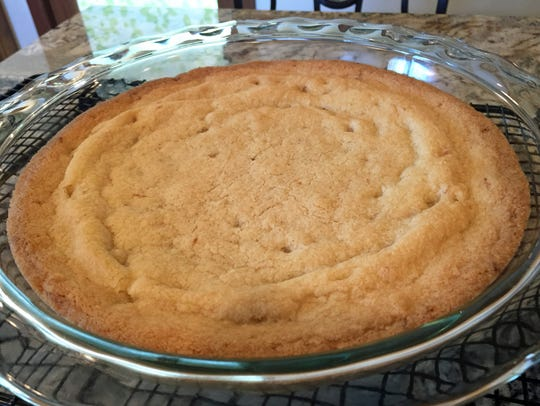 Dutch Jewish Butter Cake is baked in a round pan.