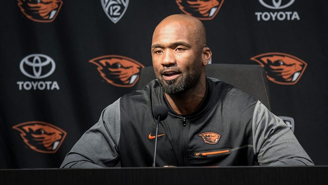 In this photo taken Oct. 9, 2017, Oregon State interim football coach Cory Hall speaks at a news conference in Corvallis.