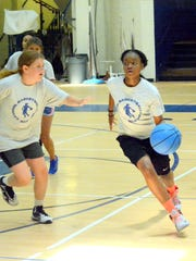 Bria Murry, 12, dribbles down the floor during five-on-five tournament competition Wednesday at the ninth annual Cavegirls basketball camp.