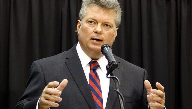 Democratic Attorney General Jim Hood speaks about his agency's attack on cybercrime as he speaks about his reelection bid to hundreds of people Thursday, Oct. 29, 2015, at Hobnob, a casual gathering sponsored by the state chamber of commerce, the Mississippi Economic Council. Many of the major candidates for statewide elected office addressed the group. The general election is next Tuesday.