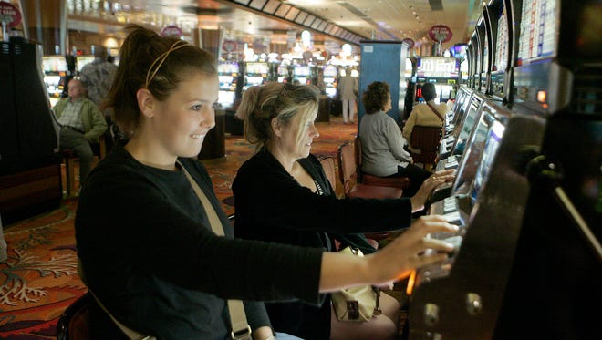 In this 2009 file photo, gamblers play the slot machines at Foxwoods Resort and Casino in Mashantucket, Conn.