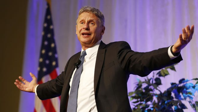 Libertarian Presidential Candidate Gary Johnson addresses the audience as he talks with President Mitch Daniels Sept. 13 on the campus of Purdue University.