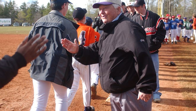 Charlie Ballew high-fives a player entering the field at the opening of Heritage Park in Simpsonville in April 2005. Ballew, an icon in the Golden Strip, died Monday at the age of 91.