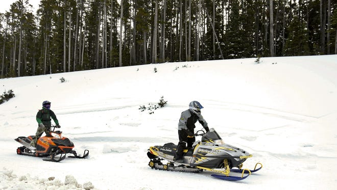 File photo of snowmobilers.