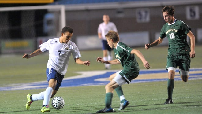 Roberson's Alex Lewis,  left, has committed to play college soccer for UNC Greensboro..